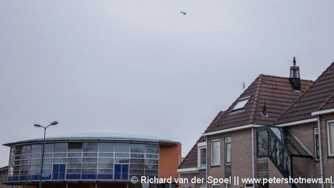Politie heli boven het  Piet Mondriaan gebouw